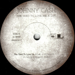 She Used To Love Me A Lot (JC & EC version) (Columbia 88843034177)